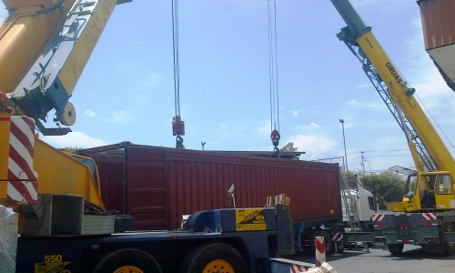 unloading container with machines in Brazil